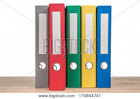 Multi-colored office folders to store documents standing next to each other, close-up