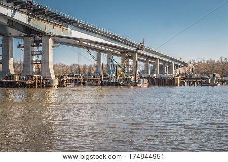 Construction of a bridge across the river. Stock image.