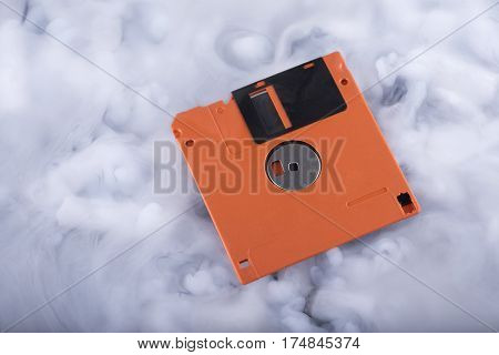 Close-up floppy disk in the clouds. Conceptual image