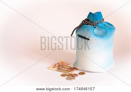 ceramic bag-shaped money box on a white background