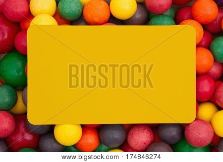 Colorful multi colored bubble gum background with yellow card