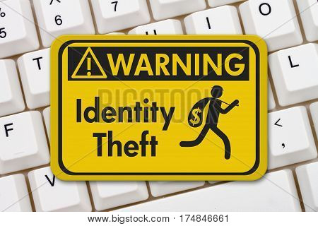 Identity theft warning sign A yellow warning sign with text Identity Theft and theft icon on a keyboard 3D Illustration