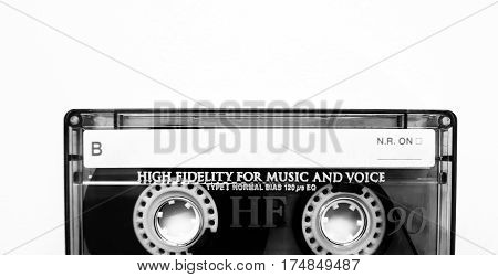 black and white photo of old music tape on a white background
