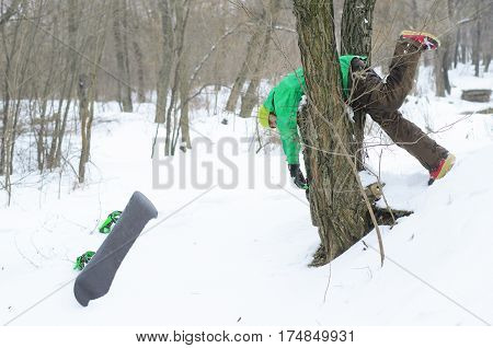 Winter Sports, Snowboarder Stuck In A Tree.