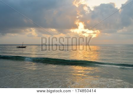 Dhow on the ocean at sunrise on Bamburi beach in Kenya