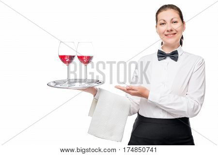 Happy Waiter With Glasses Of Wine On A Tray Welcomes Visitors