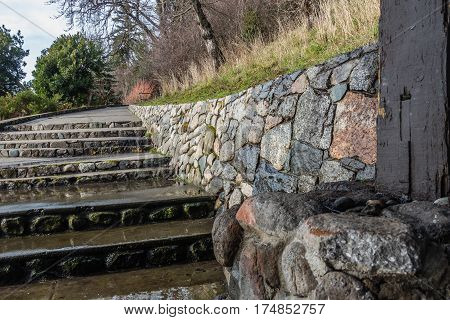 A view of stairs and a rock wall at Lincoln Park in West Seattle Washington.