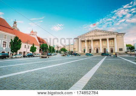 Vilnius, Lithuania. The View Of Main Facade Of Town Council, Administrative Building With Columns On Didzioji Street In Old Town In Summer Day Under Blue Sky With Clouds.