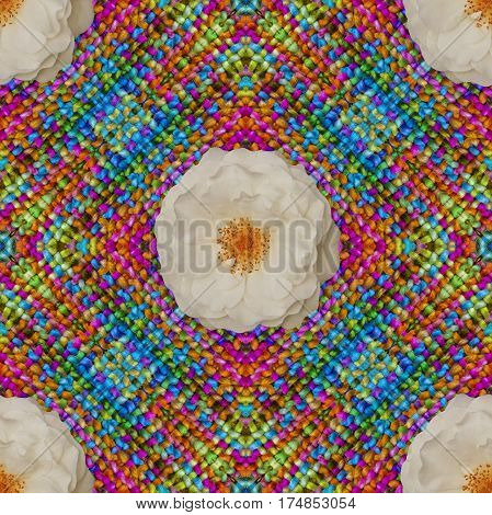 Cotton colorful background backdrop for scrapbook top view. Collage with mirror reflection. Mysterious crochet with white rose. Seamless pattern kaleidoscope montage
