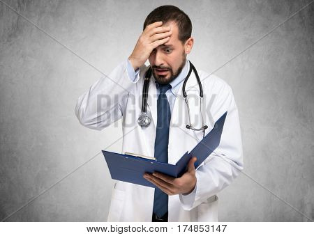 Desperate doctor looking at a document