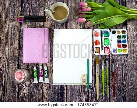 Spring Pink Tulips and Planner Watercolor Painting Wood Desktop. Flat lay styled background composition.