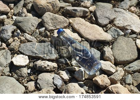 One water bottle on a stone background