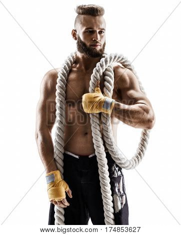 Attractive muscular man with heavy ropes on his shoulders. Photo of young man in sportswear isolated on white background. Strength and motivation.