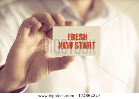 Businessman Holding Fresh New Start Message Card