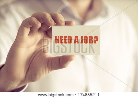 Businessman Holding Need A Job ? Message Card
