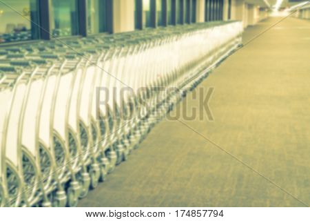 Abstract blur  luggage carts at airport terminal ( Filtered image processed vintage effect. )