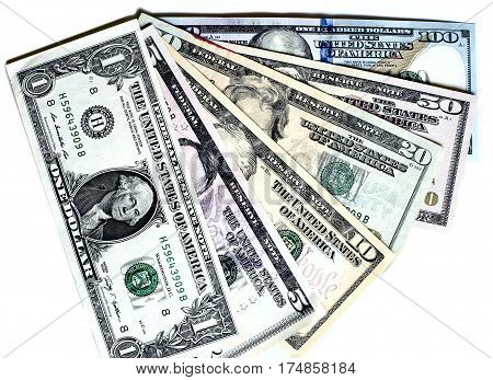 Fan shaped dollar banknotes of different denomination on white background