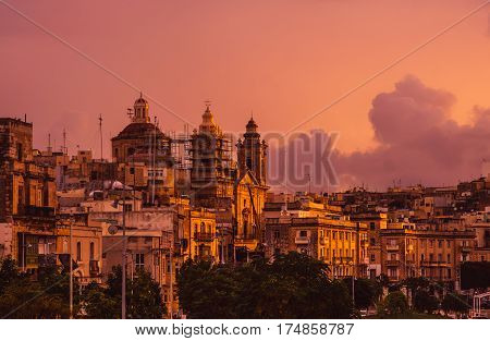 Pink Evening In Cospicua And View To Immaculate Conception Church