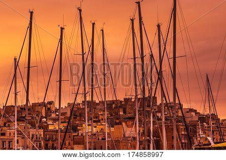 Pink evening in Senglea Malta, masts in the sky