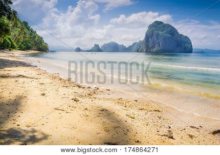 Landscape of El Nido. Sandy Beach with Huge Rock, Palawan island. Philippines.