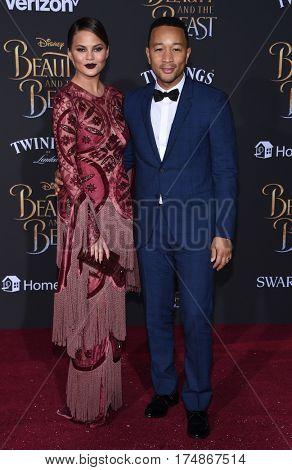 LOS ANGELES - MAR 02:  Chrissy Teigen and John Legend arrives for the