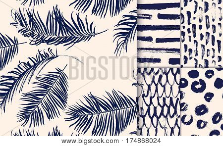 Set of blue seamless patterns drawn with dry brush.  Palm leaves, stocks, spots, net.