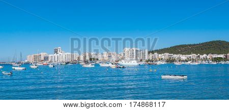 Sailboats & pleasure craft moored.  Morning in the harbor of Sant Antoni de Portmany, Ibiza town, Balearic Islands, Spain