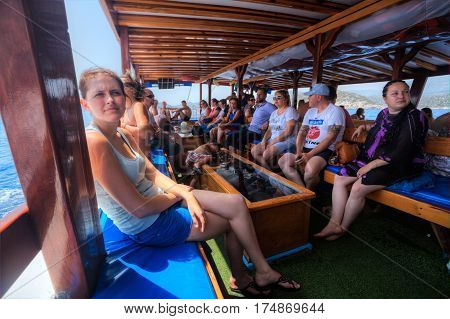 Antalya Turkey - 28 august 2014: Passengers are sitting on benches in the cabin of a tourist boat.