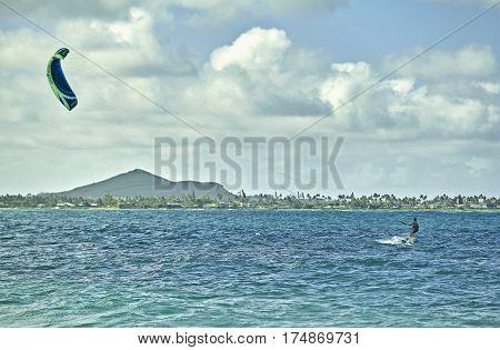 Kailua Beach, Hawaii, USA -- August 1, 2016: An unidentified man kiteboarding in Kailua Bay near KMCAS Hawaii
