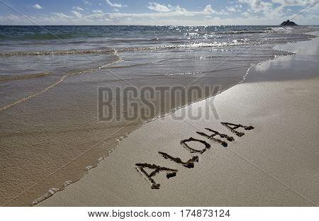 Hawaii Beach Aloha greeting writing in Sand