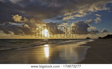 Tropical island shoreline beach at sunrise and dawn