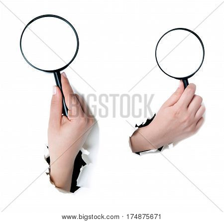 Female Hand Holding The Magnifying Glass Isolated On White Background