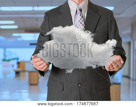 Senior male caucasian executive holding cloud computing shape. Connection to electronic records via WiFi to web services applications