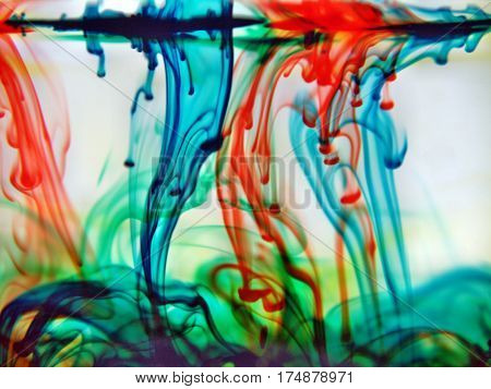 abstract red blue green yellow colors blending into water