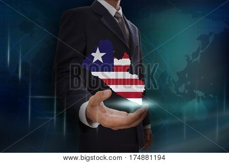 Businessman showing map of Liberia on globe background