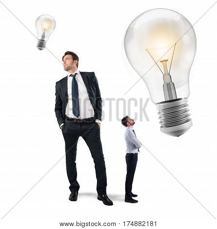 Big businessman with a small idea and small businessman with a big idea