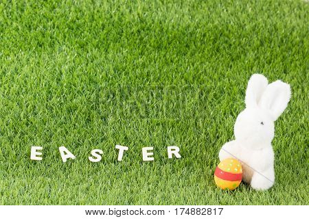 Bunny Toy And Easter Eggs With Text