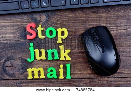 Stop junk mail words on wooden table