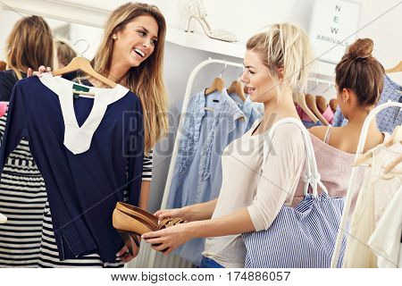 Happy women shopping for clothes