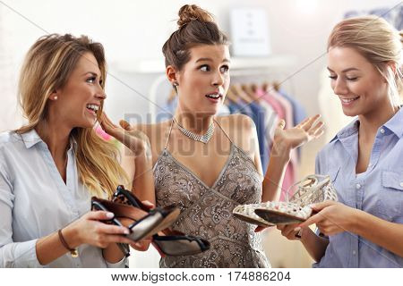 Happy woman trying to choose shoes