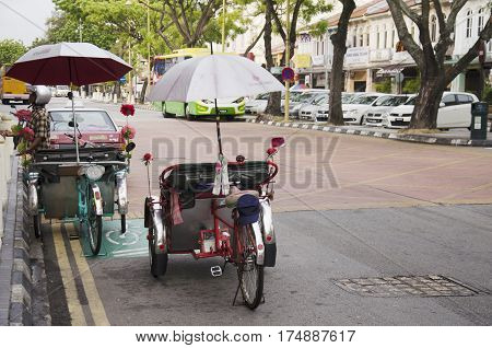 Vintage Retro Tricycle Bike Or Rickshaw Of Malaysian People Riding Service Traveller