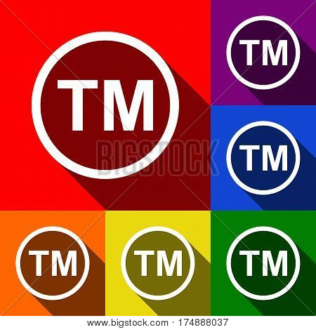 Trade mark sign. Vector. Set of icons with flat shadows at red, orange, yellow, green, blue and violet background.