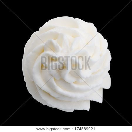 Whipped cream isolated on black background with clipping path. Top view.