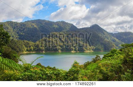 Natural landscape with lake and mountain. Outdoor travel on wild nature. Recreation zone with fresh air and water. lake in sunny day. Sunny landscape with green forest hills and lake.