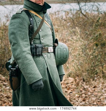 The German soldier in greatcoats and in the form of the times of World War II