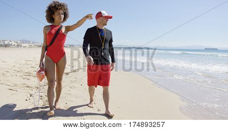 Female pointing into distance on beach