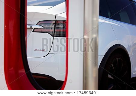 Seaside CA - May 29 2016: white tesla model x p90d at supercharger station