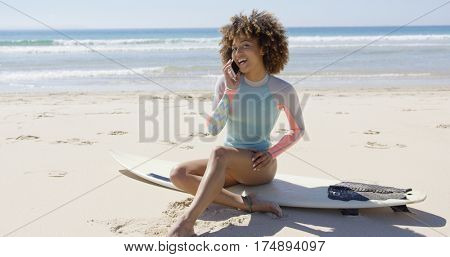 Female talking on phone on beach