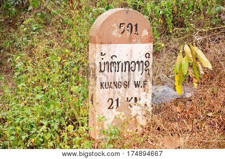 Old Milestone On The Road Information Distance To Kuang Si Falls
