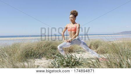 Woman warmin up on the beach